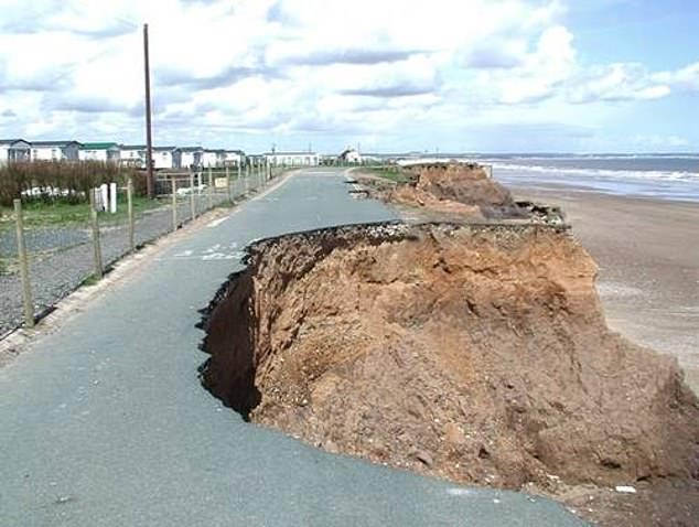 Experts found that the east coast is being hardest hit, with the erosion rate the fastest in Yorkshire and the Humber, where 56 per cent of the coastline is at risk.Pictured, a road collapsing into the sea at Skipsea Cliff, near Hornsea, in the East Riding of Yorkshire