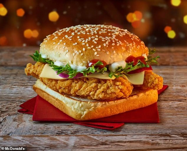The Christmas line-up also features a new burger, the Chicken Deluxe (pictured), which contains two pieces of crispy chicken with a zesty tomato relish, cool mayo, cheese, lettuce and red onion rings in a square glazed and sesame seed topped bun, and costs £5.19