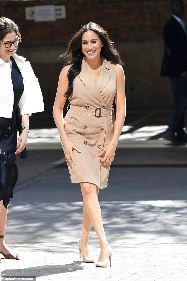 The Duchess of Sussex, pictured wearing a Banana Republic trench dress in South Africa, has been named the most influential dresser of 2019 on Lyst's annual Fashion Report