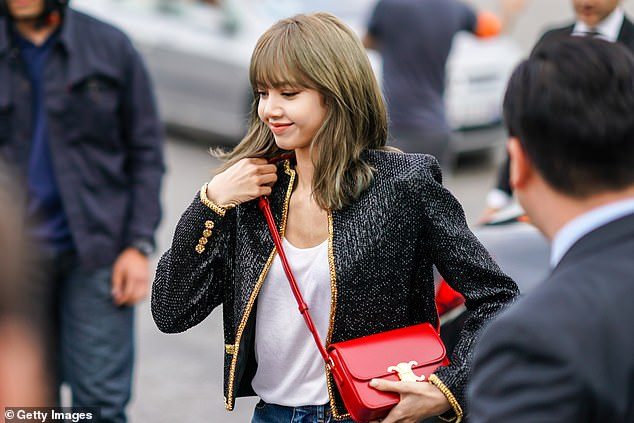 Lisa (pictured) from Blackpink, boosted sales of Celine's Triomphe bag after wearing the accessory on numerous occasions this year