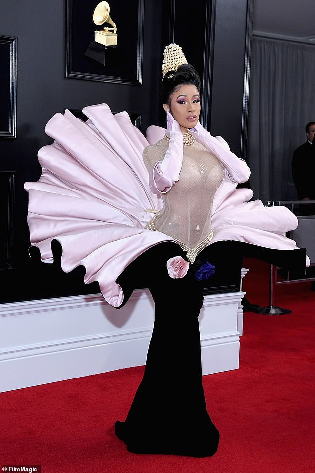 Cardi B (pictured) has slipped one place in the rankings, but her gown by Mugler worn at the Grammy Awards became one of the most mentioned fashion items this year