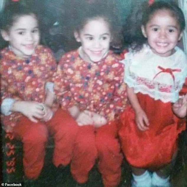 This undated photo shows Anna and Amanda Ramirez (dressed in identical outfits) as young girls posing with their cousin