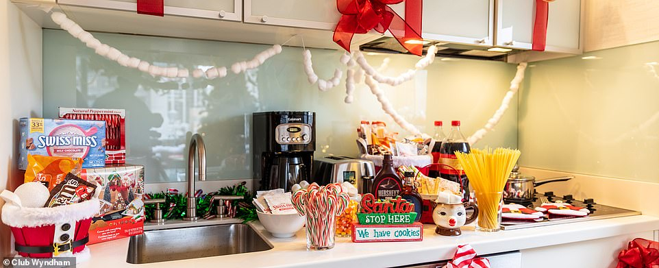 Yum! Thekitchenette area is stocked up with all of his favorite foods including spaghetti, marshmallows, chocolate sauce, Pop-Tarts, cookie-dough rolls, M&Ms, and soda