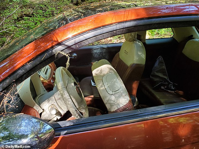DailyMailTV has obtained exclusive images of his Fiat showing scratches, dents and seen on its side with the driver's seat jolted forward