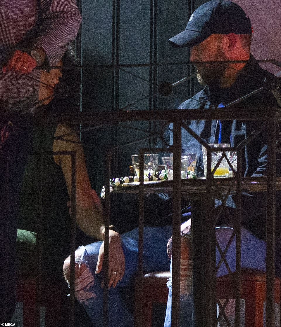 Holding hands: Pictures and footage of Justin Timberlake and his co-star Alisha Wainwright holding hands affectionately on Thursday evening in the corner of a bar have surfaced