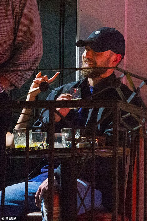 Night out: Eyewitnesses claim that they left the bar via a rear exit at about 12.30AM, Justin trying to keep a low-profile in a baseball cap, ripped jeans, and a zip-up jacket