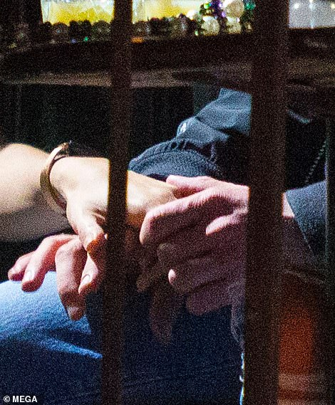 Holding hands: Justin - who has been married to Valentine's Day actress Jessica for seven years - placed both his hands around Alisha's
