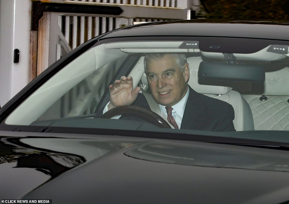 Prince Andrew smiles and waves as he leaves Windsor this morning after being banned from carrying out royal duties and being stripped of some of the perks