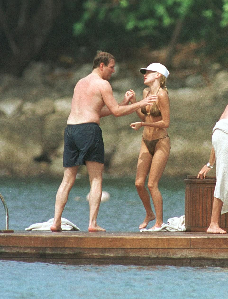 ALL HANDS ON DECK: The Prince holds hands with American supermodel Normandie White in Thailand in 2001