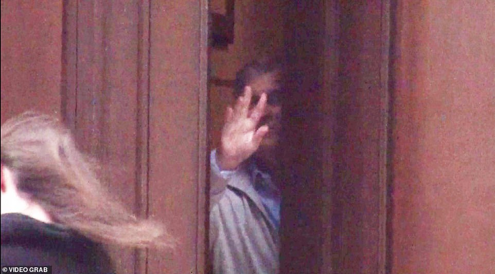 GIVING THE ROYAL WAVE:Andrew waves goodbye to a brunette he let out of the door of his friend Epstein's New York home in December 2010