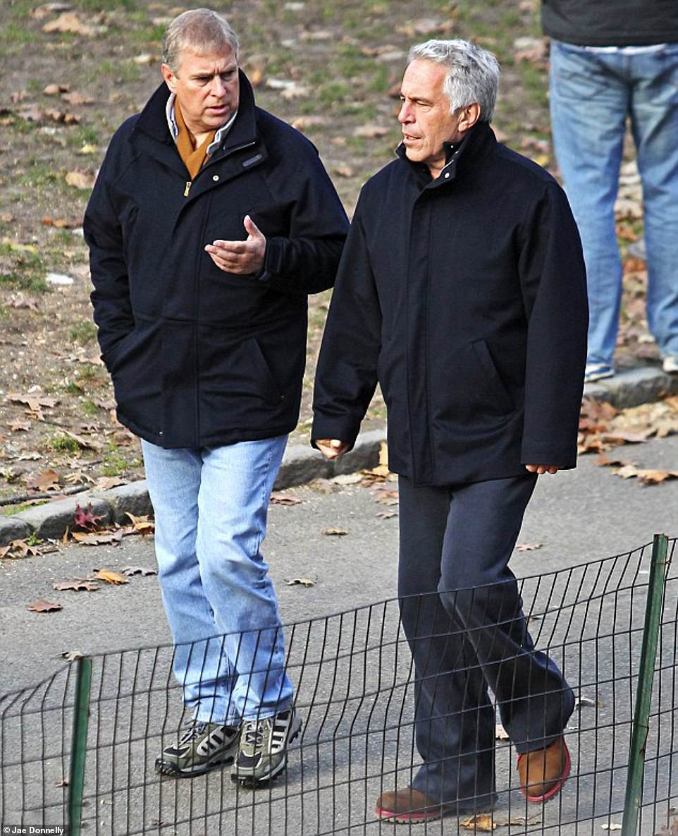 GIVING THE ROYAL WAVE: Andrew walking with disgraced financier Jeffrey Epstein in Central Park, New York, a day before he was pictured waving to a brunette from Epstein's door