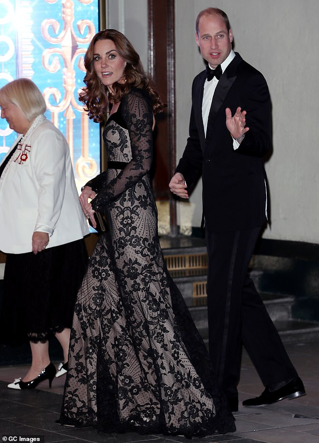 They walk the walk:The Duke and Duchess of Cambridge turned to wave to well-wishers on their way into the London Palladium last night - and were snapped on their way inside. The couple mirror each other with their walk, wave and facial expressions, Judi pointed out