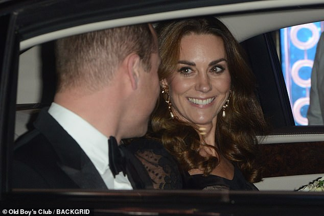 Not a mask:The Duchess of Cambridge was photographed smiling at her husband in the back of the car as they pulled away from the theatre. Judi noted that the Duchess appeared even happier once she had some alone time with her husband, as if they were on their 'first date'