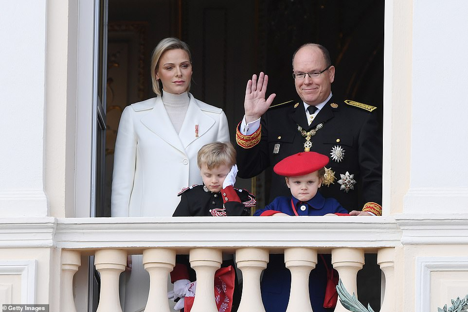 Princess Charlene, 41, cut a glamorous figure in an all white ensemble as she joined Prince Albert, 61, the reigning monarch, to mark the annual day he ascended the throne. They were seen waving from the balcony, joined by their sleepy looking twins Jacques and Gabriella, 4
