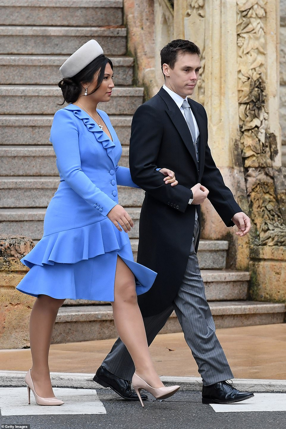 Braving the cold, Marie brought a splash of colour in a bright blue asymmetric frock , nude heels and a fascinator as she arrived with Louis