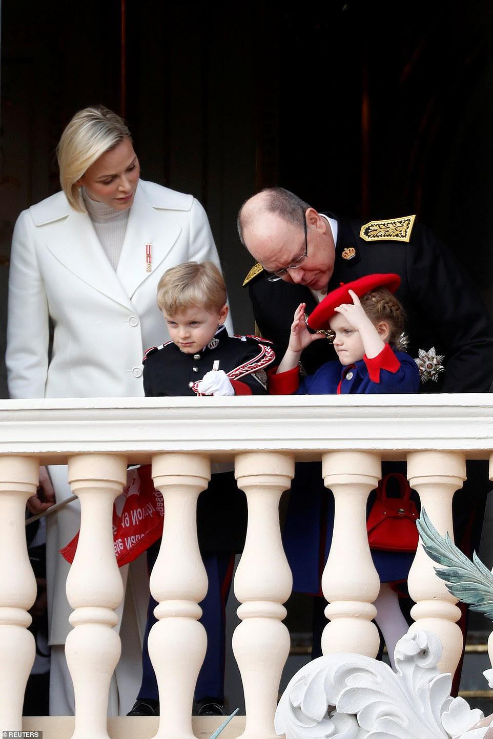 Prince Albert II of Monaco and his wife Princess Charlene, their children Prince Jacques and Princess Gabriella stand on the palace balcony