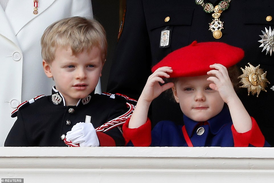 Looking smart! Monaco's Prince Jacques stared at the crowds as his twin sister Princess Gabriella played with her cute beret