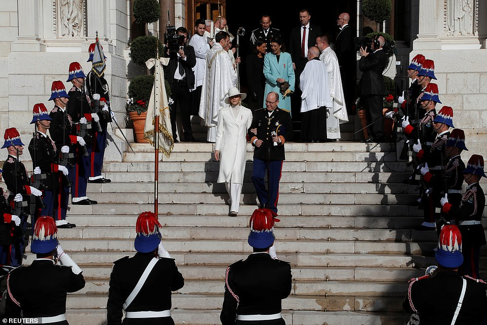 Prince Albert II of Monaco and Princess Charlene leave after a mass at Monaco Cathedral during the celebrations marking Monaco's National Day