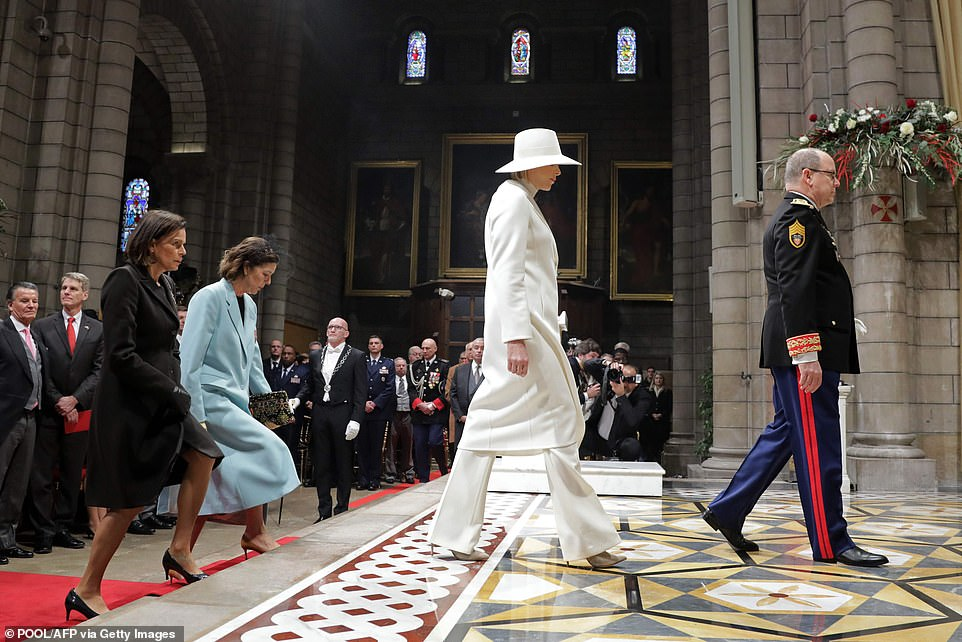 (From R) Prince Albert II of Monaco, Princess Charlene, Princess Caroline of Hanover and Princess Stephanie of Monaco arrive to attend a mass at Monaco Cathedral during the celebrations