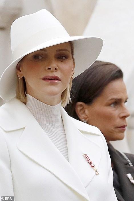 Princess Charlene of Monaco (front) and Princess Stephanie of Monaco (R)
