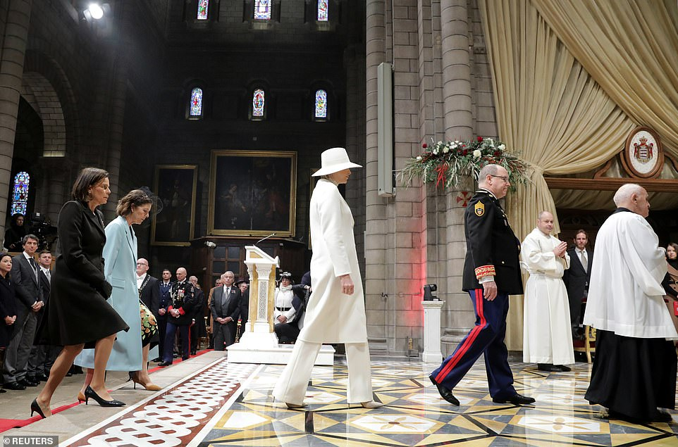 Prince Albert II of Monaco, Princess Charlene, Princess Caroline of Hanover and Princess Stephanie of Monaco arrive to attend a mass at Monaco Cathedral