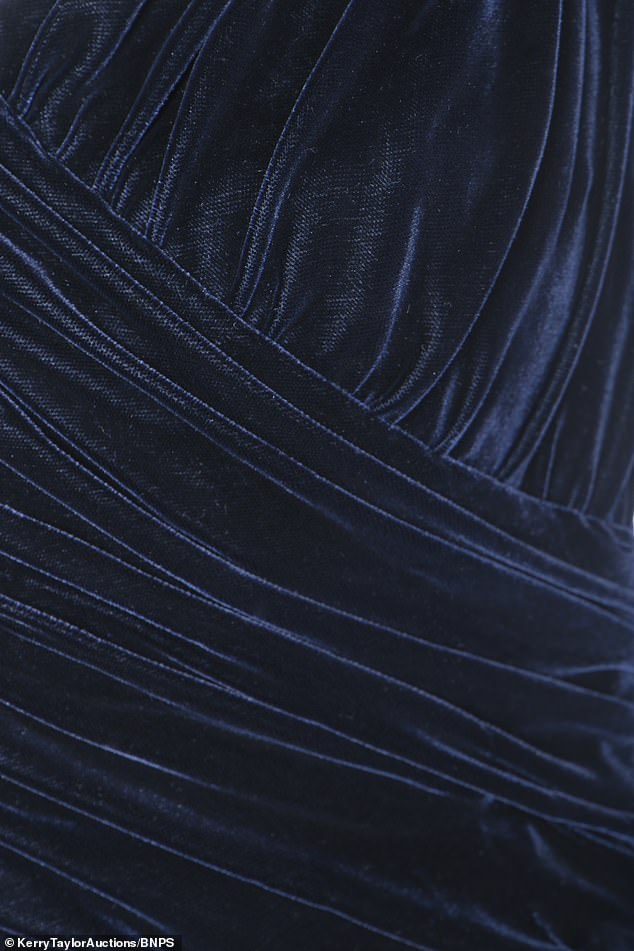 In June 1997 - just two months before her death - Diana auctioned off the dress for £420,000 to raise funds for Aids charities. Pictured: The velvet blue dress up close