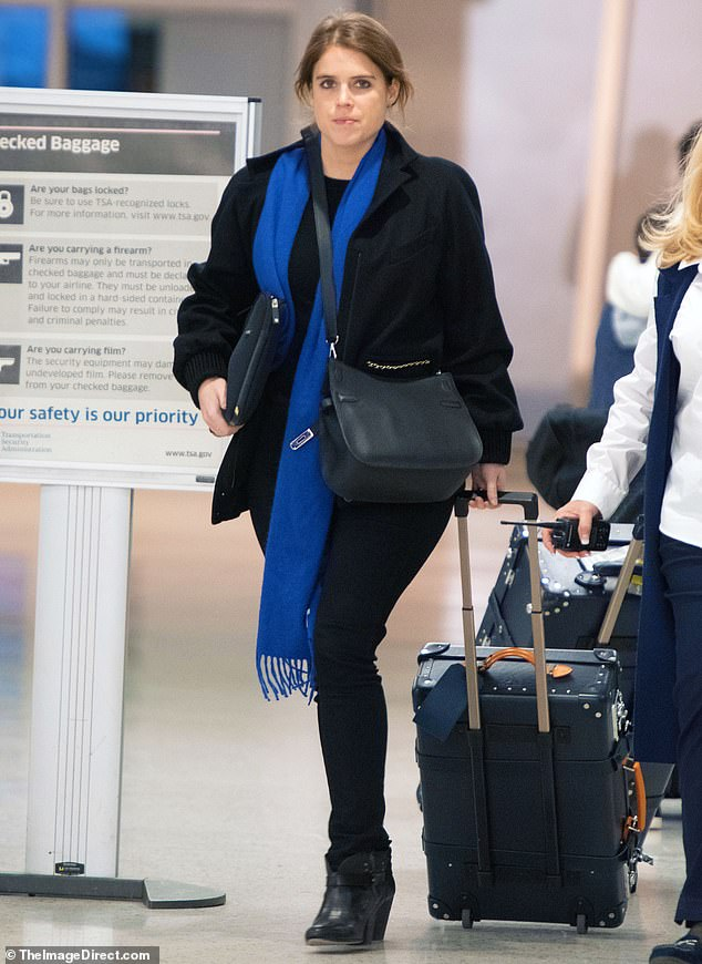The 29-year-old Royal was spotted at JFK Airport (pictured) wearing a black wool coat over a dark blouse, noir trousers and boots, adding a bright blue scarf for a splash of colour