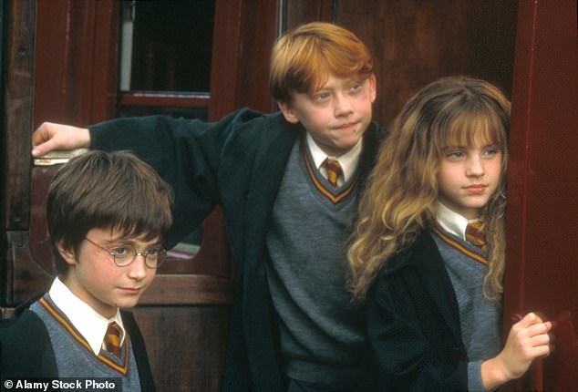 Spark:Rupert added that there was always a 'spark' between the two stars during filming for the Harry Potter franchise, which took place for ten years from 2001 until 2011 (Rupert, Emma andDaniel Radcliffe pictured together in character in 2001)