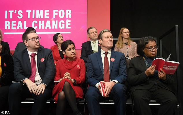 Members of the shadow cabinet listen to Labour Party leader Jeremy Corbyn speaking during the launch of his party's manifesto in Birmingham on Thursday