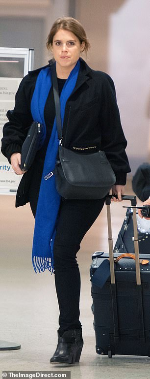 Princess Eugenie is spotted arriving at JFK Airport today hours before her father's BBC interview