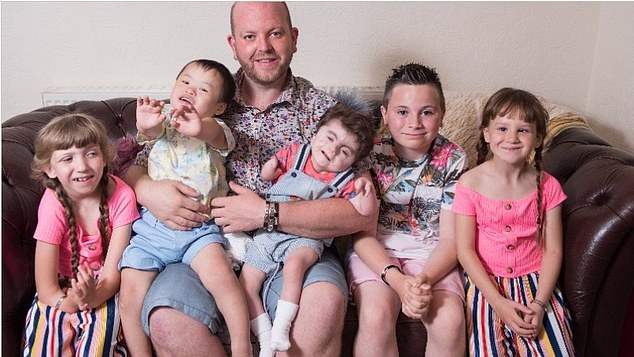 Ben Carpenter, from Huddersfield West Yorkshire, has revealed his heartbreak at the loss of his two-year-old son Noah (pictured fourth from left), who was born with a rare syndrome that affected his arms and legs