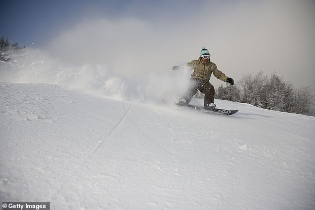 Carpenter is seen above snowboarding in Stowe, Vermont, in January 2007