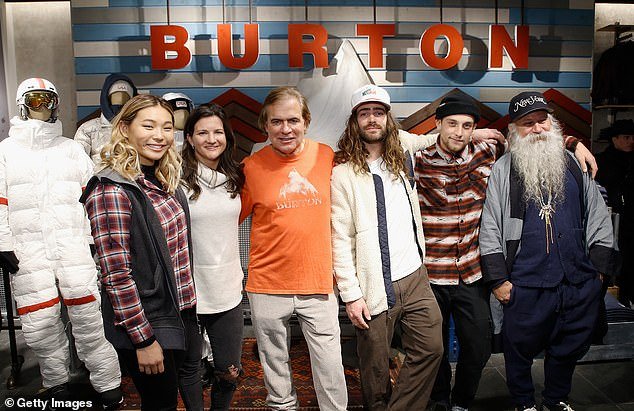 Burton Snowboards is a company whose annual sales are believed to exceed $500million. He is seen above with snowboarders, from left to right: Chloe Kim, Kelly Clark, Danny Davis, and Ben Ferguson. Burton is seen center and head designer Greg Dacyshyn is seen far right in 2017