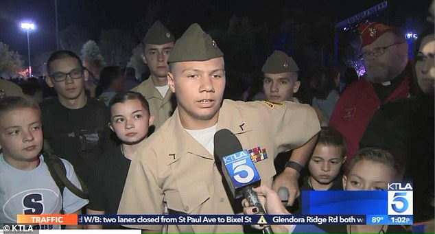 California school shooting victim Andrew Gardetto, 14 (pictured in ROTC uniform), attended a candlelight vigil on crutches on Sunday