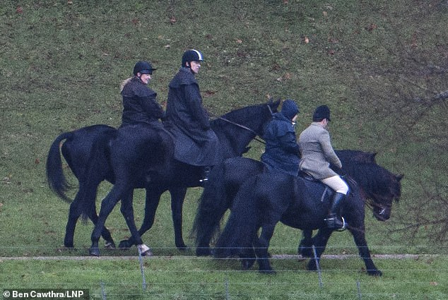 Prince Andrew looks at the Queen as they were riding through the Windsor Castle estate this morning - the first time they have been seen together since his disastrous TV interview