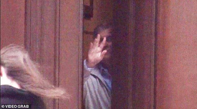 GIVING THE ROYAL WAVE:Andrew waves goodbye to a brunette he let out of the door of his friend Epstein¿s New York home in December 2010