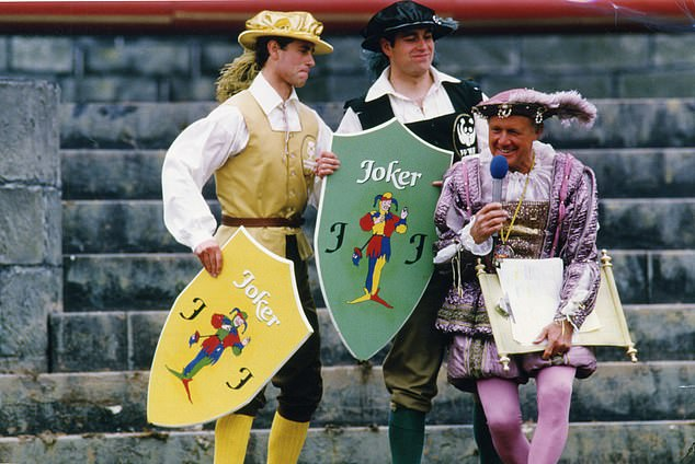 THE CLOWN PRINCE:Andrew plays his Joker with host Stuart Hall during the It¿s A Royal Knockout in June 1987. The event was later described as undignified