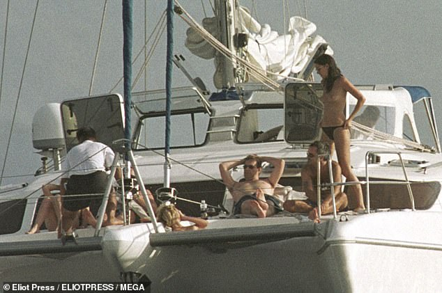 ALL HANDS ON DECK:sunbathing with a topless woman on a yacht on the same break in 2001
