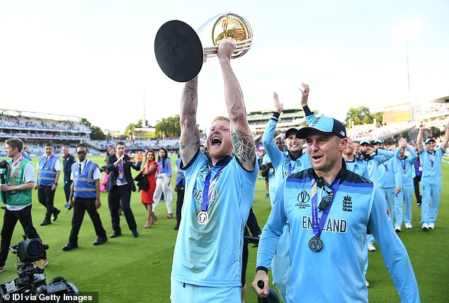 The 28-year-old lifts the World Cup aloft alongside close friend Joe Root as England celebrate