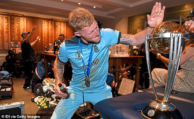 Inside the dressing room he is seen in high spirits as he slaps down on the World Cup trophy