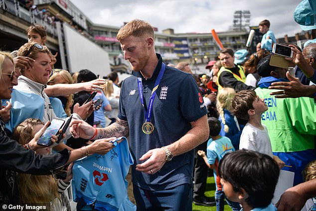 He signs t-shirts and autographs as England celebrate their Cricket World Cup win at the Oval
