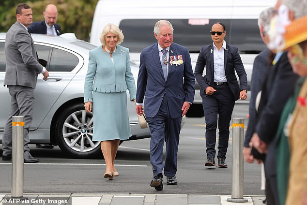 Prince Charles prepares to lay a wreath at the Mount Roskill War Memorial Park in Auckland, New Zealand, on the first day of their royal tour