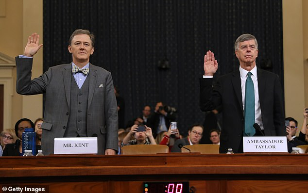 Deputy Assistant Secretary George Kent (L) and Bill Taylor are pictured at the start of the first open hearing in the impeachment inquiry into US President Donald Trump in Washington