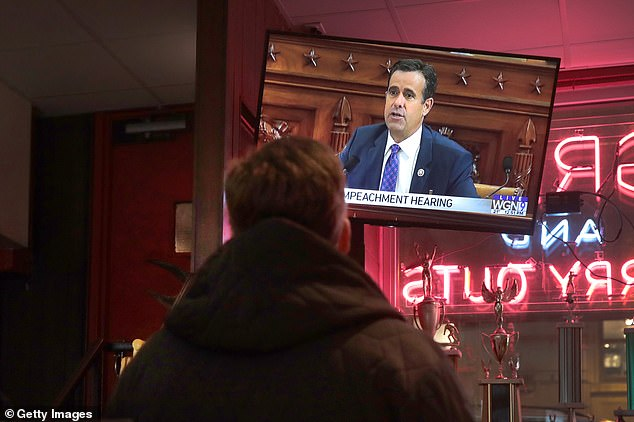 With a potential television audience of tens of millions looking on, the two witnesses were questioned for hours (pictured is the hearing being shown in a the Billy Goat Tavern in Chicago, Illinois).Some Trump voters undoubtedly see the allegations as serious and worthy of investigation, but the more general reaction is: 'Oh, again?' and it might take some convincing to show people it amounts to more than a witch hunt