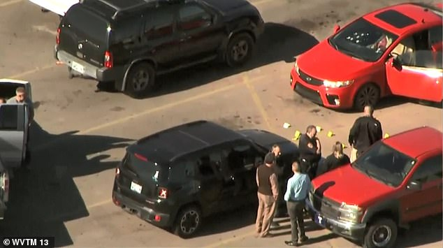 Officers from the Duncan Police Department said the three dead include two men and a woman. A witness claimed that the shooter fired nine rounds, killing the two victims. Aerial footage (pictured) shows police cordoning off a large area of the parking lot