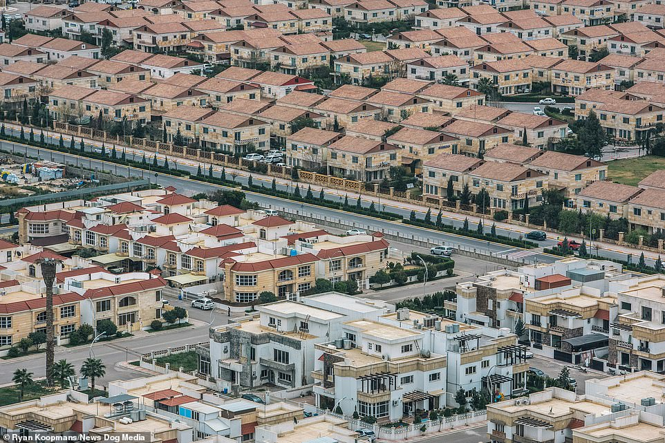 Baghdad, the capital of Iraq, 2015. Rows of suburban houses with greenery can be seen in the city which was founded in the eighth century