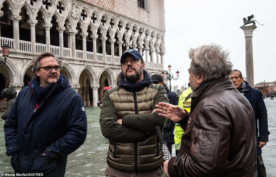 Right-wing leader Matteo Salvini (centre) inspects the damage in St Mark's Square which was closed to tourists today