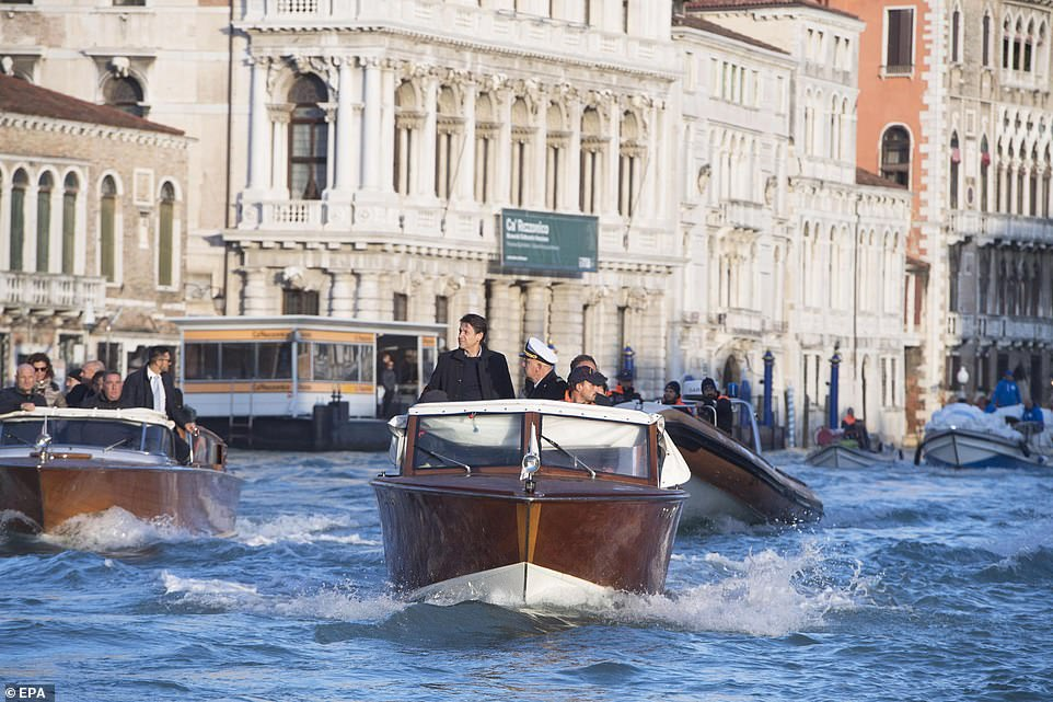 Inspection: Italian prime minister Giuseppe Conte rides on a boat yesterday as he surveys the flood damage in Venice