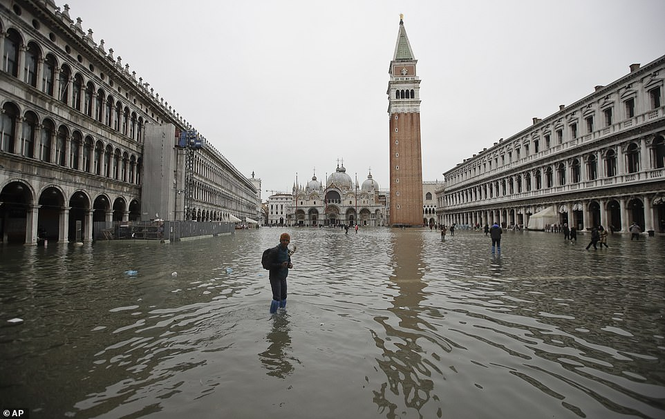 The whole of St Mark's Square is seen submerged yesterday, causing 'irreparable' damage to the historic St Mark's Basilica