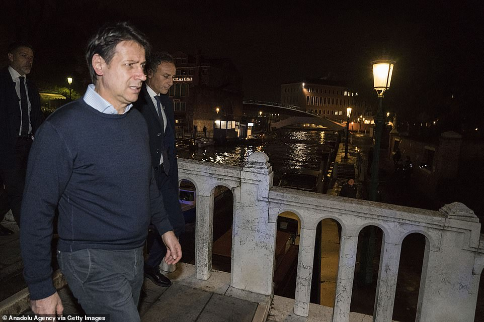 PM Conte inspects the area after catastrophic floods which have led his government to declare a state of emergency